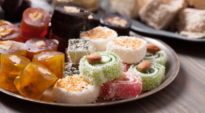 Turkish delight lokum with nuts on metal plate